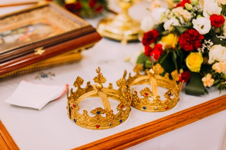 church flower: Two wedding crowns on the church altar with flower decoration.