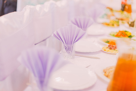 catered: Wedding tables set for fine dining or another catered event.