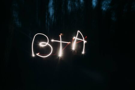 initials: Light painting of initials on night background.