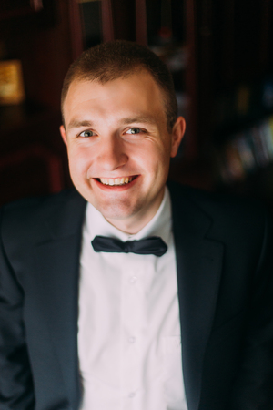 charisma: Confident and charisma. Close up portrait of happy young man with bowtie looking at camera.