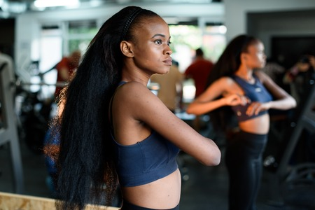 american sport: Fitness, sport, dance and lifestyle concept - beautiful black african american woman training in gym or studio.
