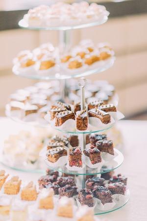 dessert buffet: Dessert buffet close-up with delicious sweet chocolate icing bakery.
