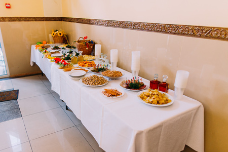 catering food: Luxury served catering table of different salty snacks along with other food.