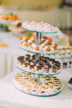 dessert buffet: Dessert buffet close-up with delicious sweet chocolate and cream bakery.