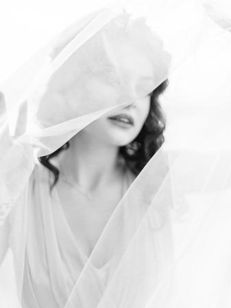 diamante negro: Sensual portrait of gorgeous brunette bride in veil close-up in black and white. Foto de archivo