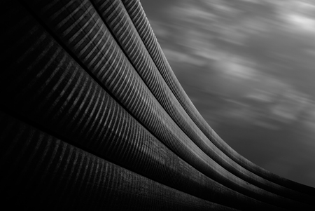 grey sky: Modern abstract architectural shapes on the grey sky background.