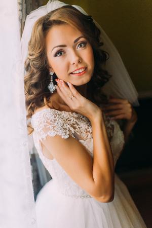 Close-up portrait of happy beautiful bride in wedding dress. Stock Photo