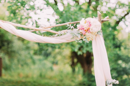 floral decoration: Close-up details of the wedding arch with pink flowers, summer.