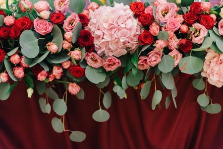 Pink large hydrangea put in flower festoon on dinner table