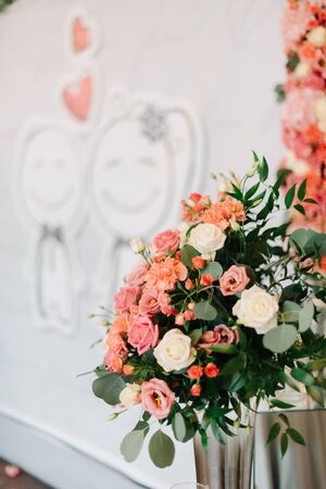Look over beautiful pink bouquet at wedding altar Stock Photo