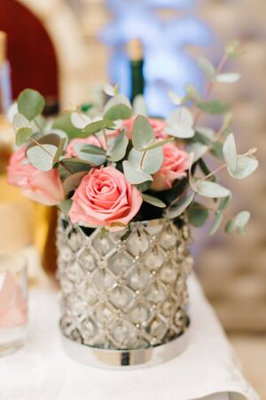 Gorgeous glass vase holds pink pastel roses