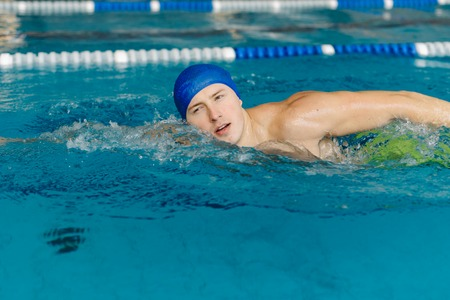 close up photo of young sportsman swimming in pool Reklamní fotografie