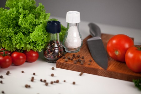 pepperbox: Set on vegetables, pepperbox, saltbox and kitchen appliances Stock Photo