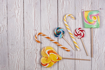 COmposition of sweet candies placed on a wooden board