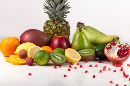 Many tropical fresh fruits placed on a white background. Studio shot