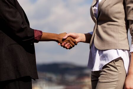 Close up shot of shaking hands. Two businesswomen shaking hands with each other after good deal.