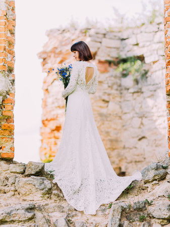 engage: The sensitive view of the bride`s back near ruins.