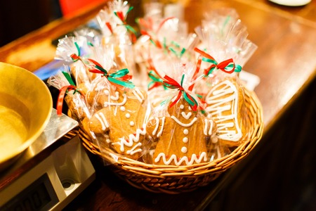 The horizontal close-up view of the Christmas cookies placed in the straw basket in the shop Stock Photo