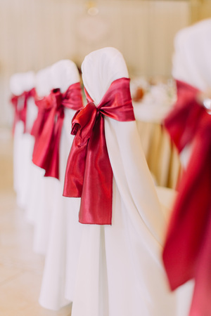 Side close-up view of the chaircloth with red silk ribbons