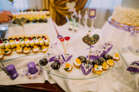 Lovely heart on the stick in placed in the cupcake. The dessert wedding table