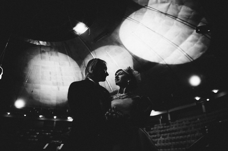 Married wedding couple dancing in a backlit scenario. Tender moment of first dance. Black and white image. Luxurious lifestyle Stok Fotoğraf