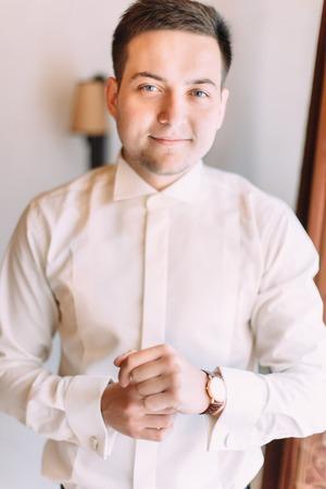 Handsome smiling groom. Half-length portrait.