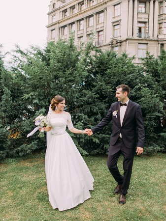 Full-length view of the walk of newlyweds in the garden.