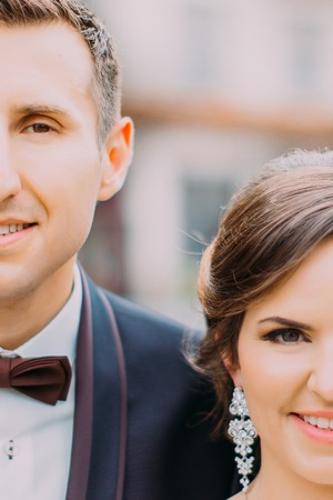 The close-up portrait of part of newlyweds faces.