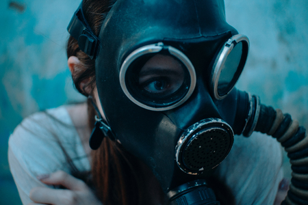 Portrait of woman in gas mask. Close-up