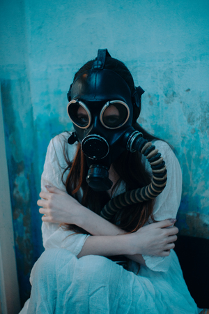 Portrait of woman in gas mask. 스톡 콘텐츠 - 125641630