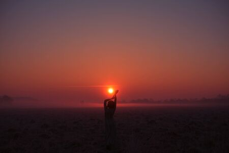 Desert in Egypt. Rock and sunset. Girl in egypt style clothes. Evening, calm orange/purple colours