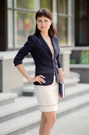 Business woman with a notebook