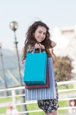 Smiling, happy, beautiful girl with shopping bags Stock Photo