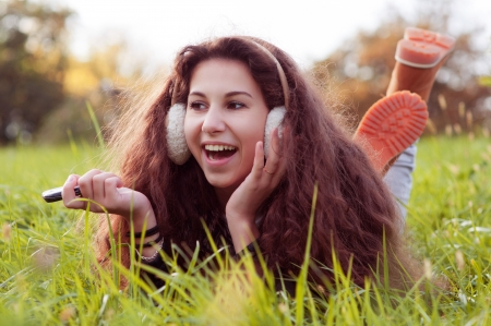 Girl lying on the grass, laughing Stock Photo