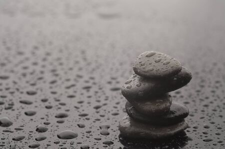 Spa massage stones with water drops, close up Stock Photo