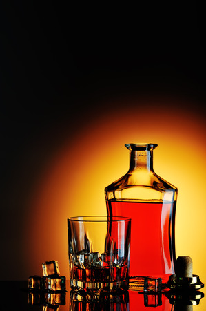 Bottle of whisky and glass Stock Photo