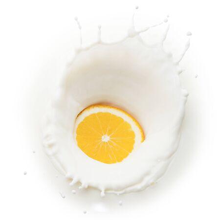 Orange slice in milk splash