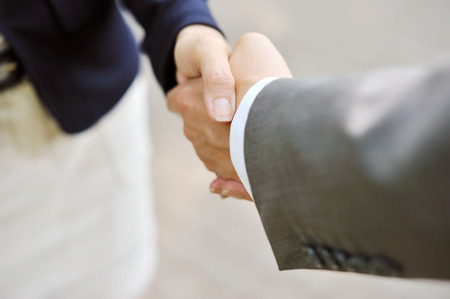 business relationship: Business handshake, men and women
