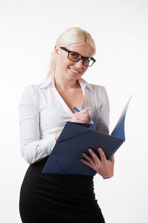 Business woman wearing glasses holding a folder