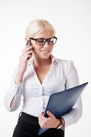 Blonde business woman using smartphone