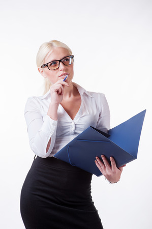 Thoughtful young business woman holding folder
