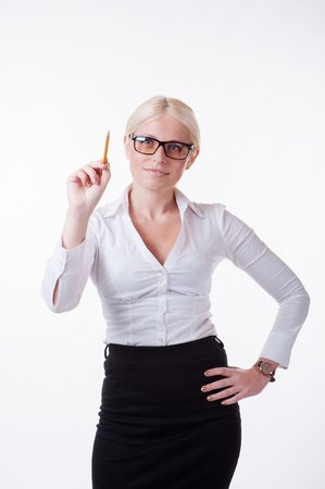 Business woman with pen writing in the air Stock Photo