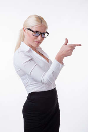 hair tied: Businesswoman is showing something with her finger Stock Photo
