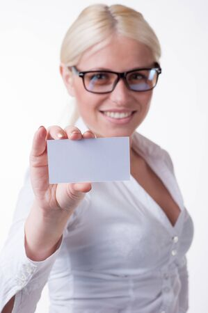 Happy blond woman showing blank business card photo
