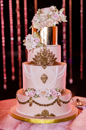 Closeup of white wedding cake with flowers. Wedding ceremony.
