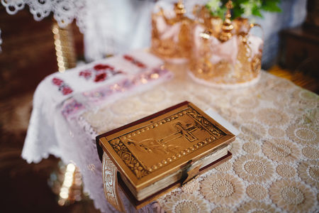 Bible on altar table. Faith and religion concept. Preaching background. Church interior. Lords table concept. Holy holidays and Christmas concept. Christianity tradition.