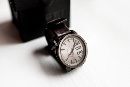 mens watch on a light background.Accessories for a businessman.