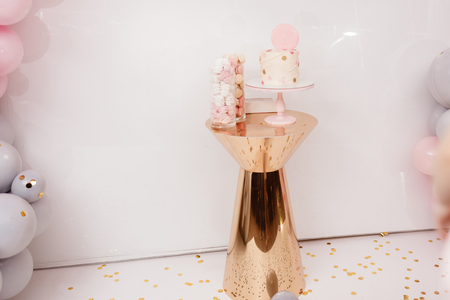 Delicious wedding reception. Birthday Cake on a background balloons party decor. Copy space. Celebration concept. Trendy Cake. Candy bar. Table with sweets, dessert. Imagens