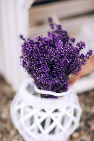 bouquet of lavender. Pile of lavender flower bouquets on a wooden old bench in a summer garden Imagens