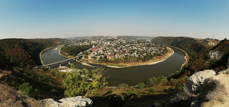 Top picturesque view of the summer Dnister river bend canyon and famous Ukrainian Zalischyky town. Ternopil region, Ukraine, Europe. miracles of nature. panorama.